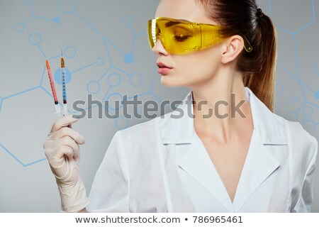 beautiful girl holding syringe Stock photo © svetography
