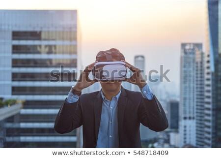 zakenman · virtueel · realiteit · stofbril · verwonderd · gegevens - stockfoto © stevanovicigor