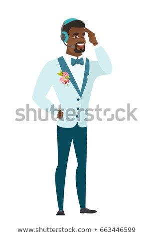 Young african-american groom in headset. Stock photo © RAStudio