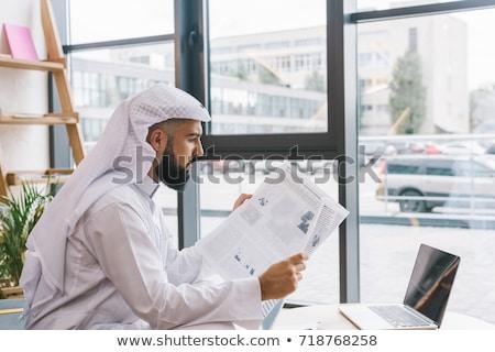 muslim businessman reading newspaper stock photo © rastudio