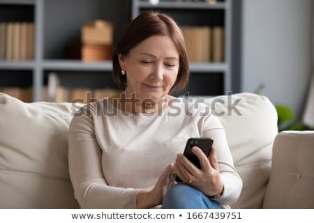 Woman looking at phone Stock photo © IS2