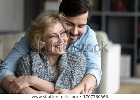 Stock photo: Mother and son snuggling together
