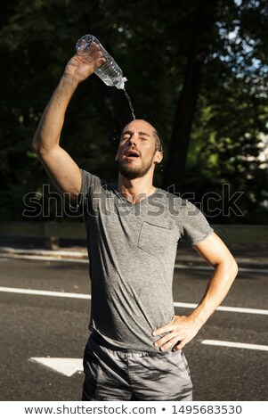 Runner pouring water on his head Stock photo © IS2