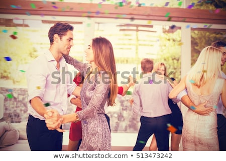 A couple dancing in a swimming pool Stock photo © IS2