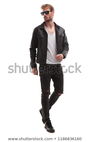 curious blonde fashion man stepping and looking to side Stock photo © feedough