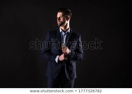 arrogant young elegant man buttoning his suit Stock photo © feedough