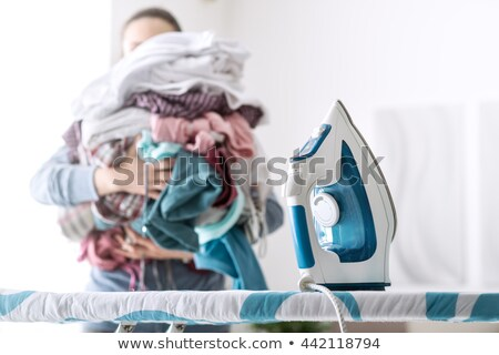 Messy Clothes And Iron On Ironing Board Stock photo © AndreyPopov