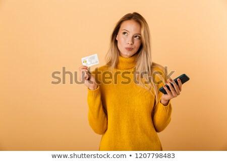 pensativo · mulher · cartão · de · crédito · brilhante · quadro · dinheiro - foto stock © deandrobot