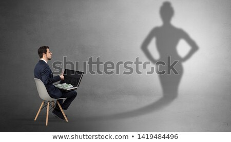 Businessman staying and offering stuffs to a shadow woman Stock photo © ra2studio