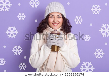 Stylish brunette girl holding thermos with warm coffee. stock photo © studiolucky
