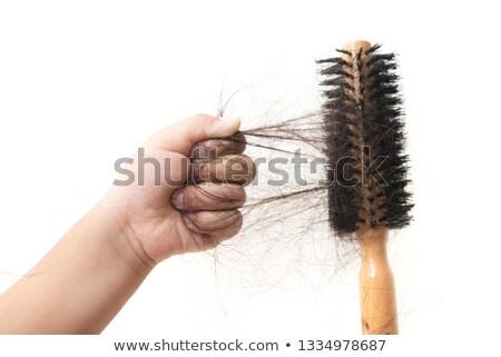 Kéz tart fésű elveszett haj emberi kéz Stock fotó © szefei