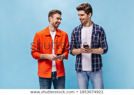Izgatott fiatalember visel kockás póló ugrik Stock fotó © deandrobot