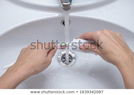 Közelkép nő fogkrém fogkefe fürdőszoba orvosi Stock fotó © deandrobot