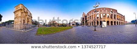 Colosseum and Arch of Constantine square panoramic dawn view in  Stock photo © xbrchx