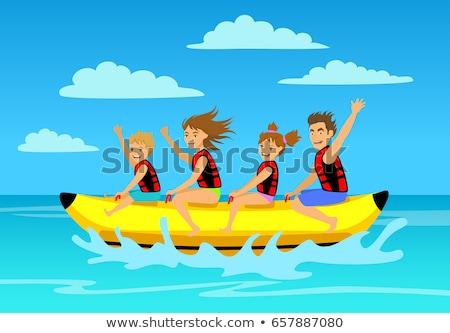 Happy Family Riding on Inflatable Banana on Sea Stock photo © robuart
