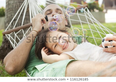 Father and daughter in a hammock on the nature Stock photo © Lopolo
