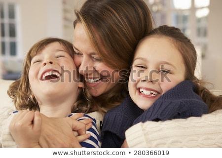 affettuoso · madre · figlio · figlia · seduta · divano - foto d'archivio © lopolo