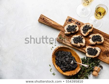 Preto caviar tigela sanduíches champanhe Foto stock © Illia