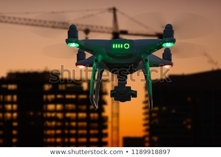 Silhouette of Unmanned Aircraft System Drone (UAV) Quadcopter Dr Stock photo © feverpitch