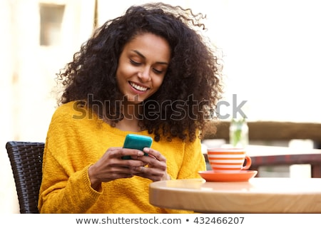 Portrait of a phoning woman sitting relaxed at outdoors cafe and Stock photo © HASLOO
