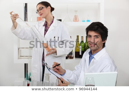 Oenologists analysing different wines Stock photo © photography33