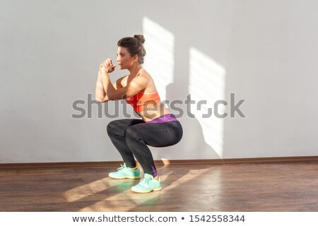 Profile shot of a crouching brunette Stock photo © stryjek