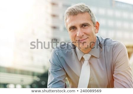 glimlachend · nadenkend · senior · zakenman · portret · kantoor - stockfoto © stockyimages