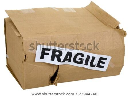 Crumpled cardboard box with inscription 'fragile'  Stock photo © pzaxe