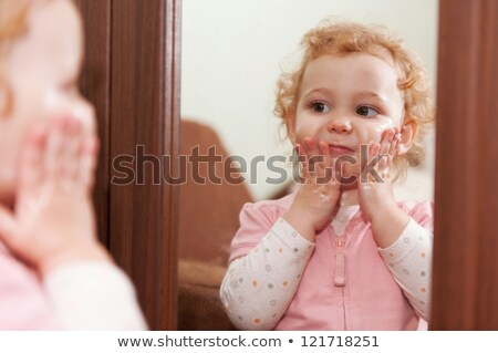 Young blonde and her reflection in a mirror stock photo © acidgrey