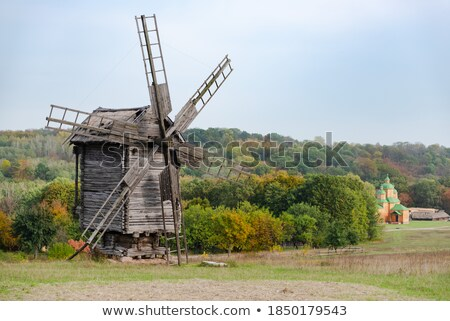 old wooden windmill on the horizon stock photo © borysshevchuk