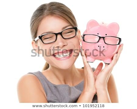 Beautiful businesswoman with piggybank  over white stock photo © lunamarina
