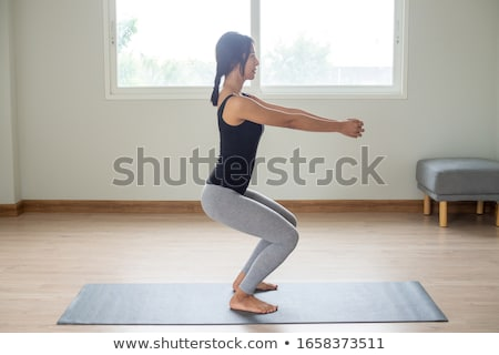 Woman extending arms in yoga Stock photo © phakimata