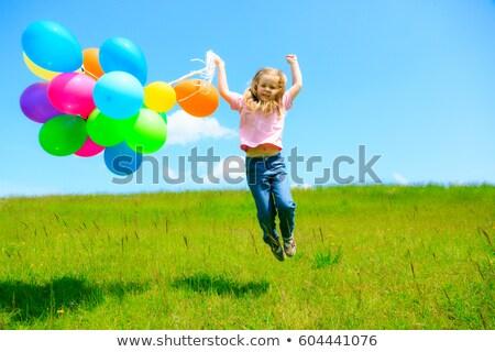 menina · feliz · corrida · prado · colorido · balões · pais - foto stock © mady70