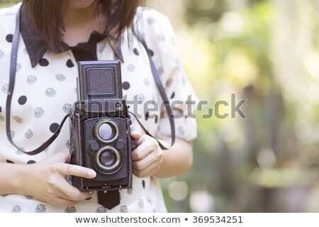 girl with old tlr camera stock photo © dashapetrenko