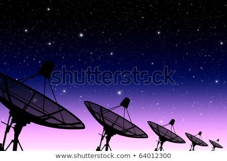 black satellite dish against a blue sky stock photo © njnightsky