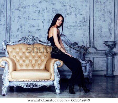 Dark-haired woman in the luxury bedroom Stock photo © majdansky