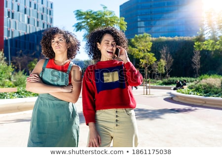 Woman Holding Arms Crossed While Her Lover Is Holding Her Stockfoto © 2Design
