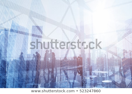 Double exposure of a city and professional businessman standing on white background Stock photo © deandrobot