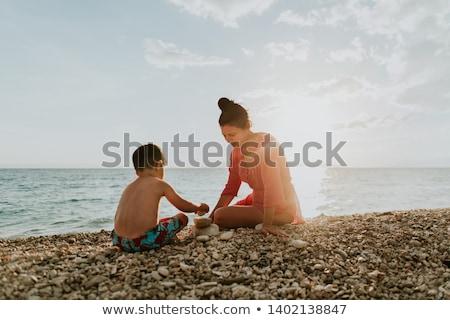 Chłopca kamień plaży charakter dziecko Zdjęcia stock © Paha_L