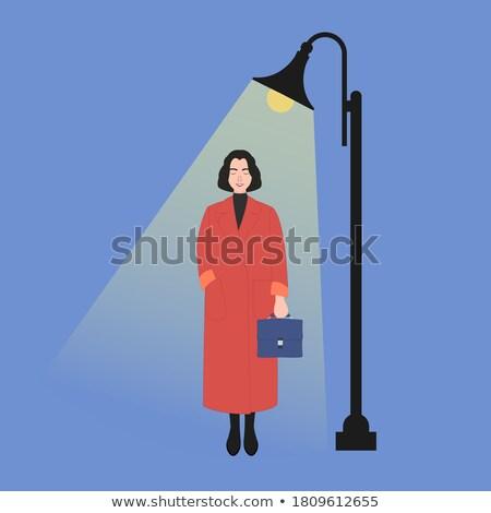 Samotny przypadkowy kobieta spaceru w dół ulicy Zdjęcia stock © stevanovicigor