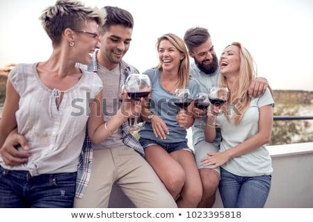 пять улыбаясь друзей балкона семьи девушки Сток-фото © Paha_L