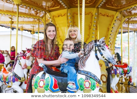 mother with baby on carrousel Stock photo © Paha_L