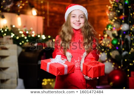 girl with  bright tinsel in store Stock photo © Paha_L