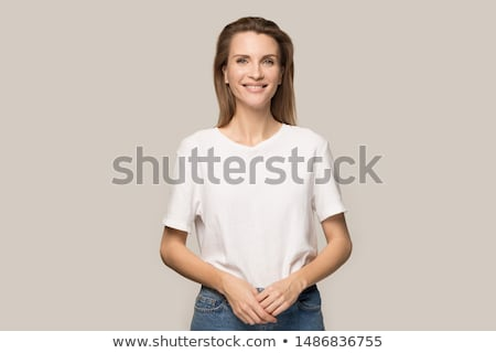 stylish young woman posing in clear background Stock photo © Studiotrebuchet