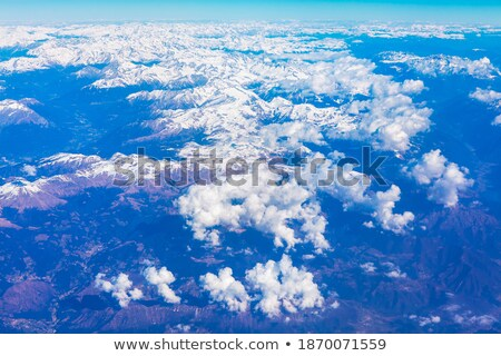 Snowy mountain range of heights. View from the airplane Stock photo © Vanzyst