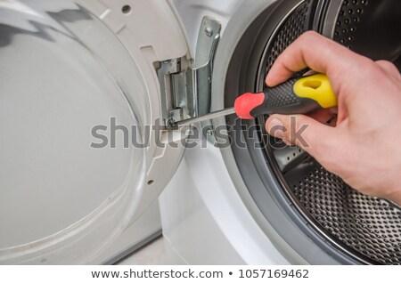 man's hand adjusting washing machine Stock photo © ssuaphoto