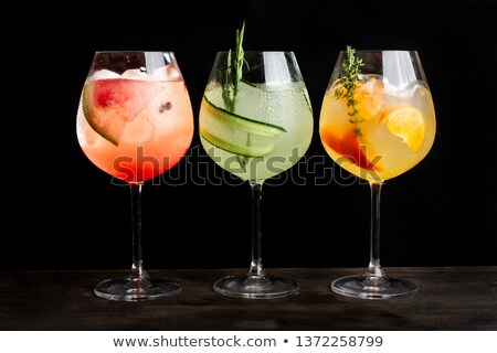 Three glasses of red fruit juice with ice Stock photo © tish1