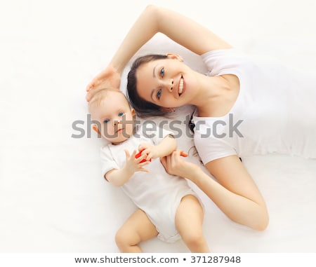 pretty mother and baby on bed stock photo © deandrobot