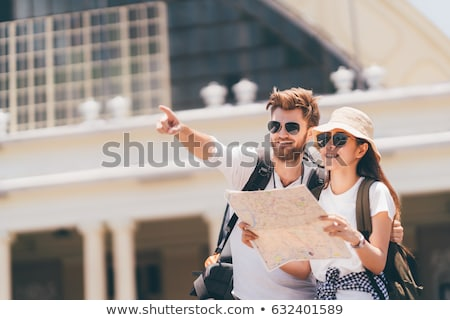 multiethnic travelers with map stock photo © LightFieldStudios