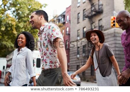Csoport sétál utca férfi pár városi Stock fotó © IS2